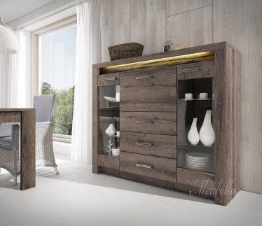 Dressoir Invido is een eigentijds en praktisch dressoir met een landelijke stijl. Dit model beschikt over 2 deuren, 1 klapdeur en drie lades. Het meubel is uitgevoerd in donker eiken en beschikt over LED-verlichting.