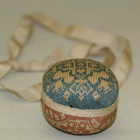 knitted silk pinballs, worked on fine steel 'makkin wires' little more than a millimetre in diameter, at a minimum gauge of ten stitches to the centimetre.