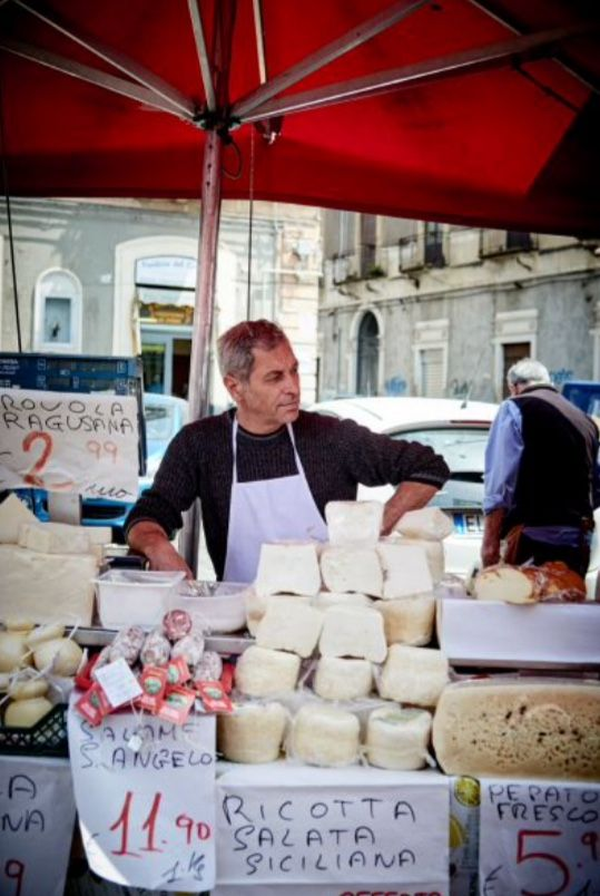 """This market salesman is from our feature """"Splendours of Sicily"""""""