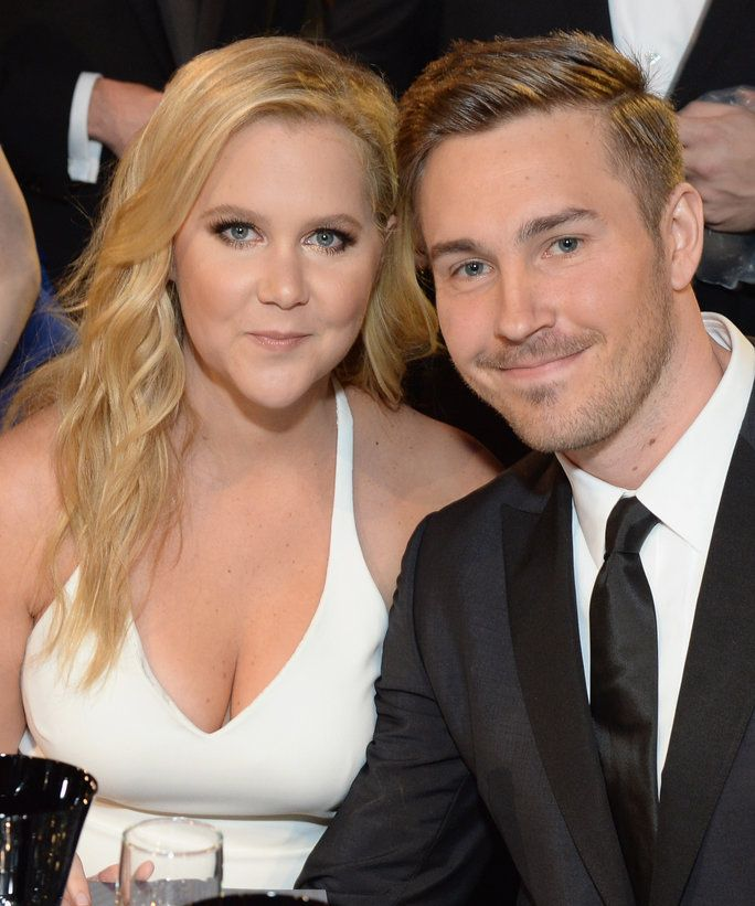 Amy Schumer keeps it feminine in a floral print dress as
