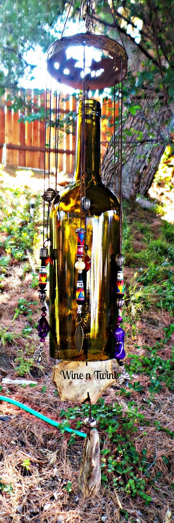 This is an original, one-of-a-kind wind chime. Made from a recycled wine bottle Tom has added a metal top which a mixture handmade Southwestern Beads