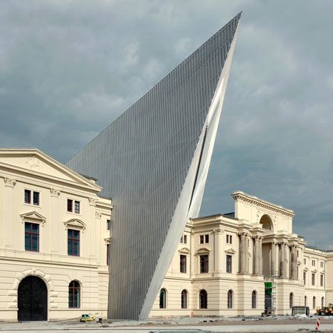 New York architect Daniel Libeskind has driven a pointed steel and glass shard through the heart of the war museum in Dresden, Germany (The sharp tip of the structure points eastwards, to the source of firebombs dropped during the war), which reopens on October 14 after a 22-year closure.    The five-story triangular wedge extends the existing galleries of the Museum of Military History, making it the largest museum in Germany.