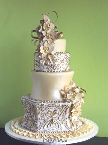 Gold wedding cake with phalaenopsis orchids