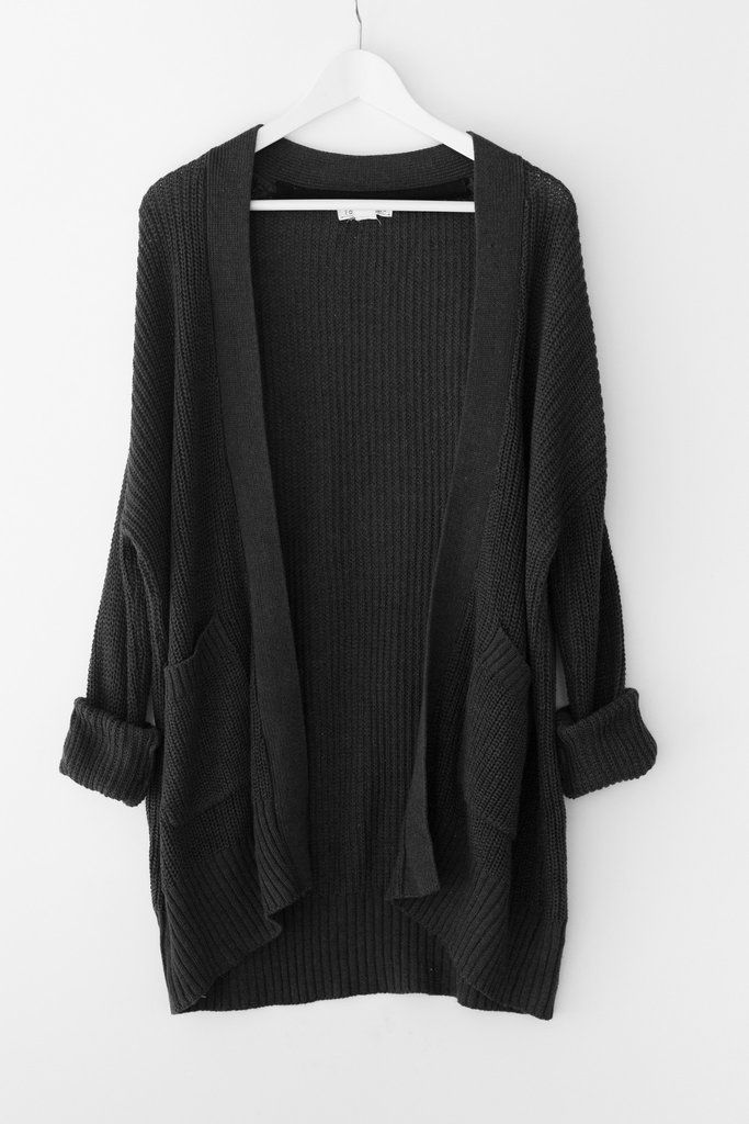 Chunky knitted cardigan with an open front Large patched front pockets Long sleeves Dropped shoulder and loose fit Available in oatmeal or charcoal 60% Cotton 2