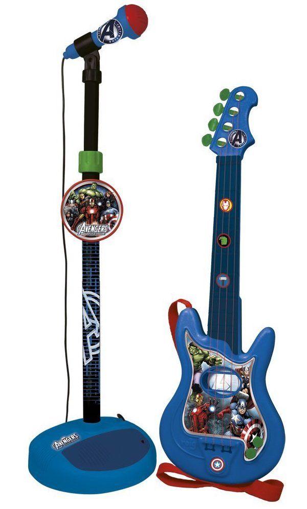 Claudio Reig - Foto Conjunto de guitarra y micrófono. Guitarra de 4 cuerdas. Micrófono con cable y pie extensible. Conjunto guitarra y micro amplificador.