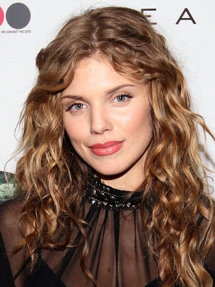 CURLY LONG LAYERS  Length is key when your curls are tight, like Annalynne McCord's—long layers help weigh them down. If you want a soft, face-framing look, ask for layers that start no higher than the chin or collarbone, so curls have enough weight to hang down. To get McCord's springy movement and volume, wring the water out of your hair after showering and work a light cream, through damp hair to control the curls.