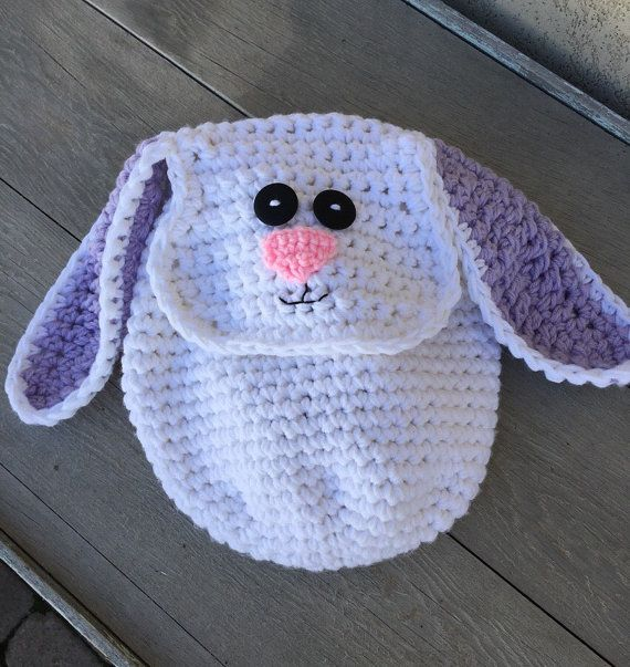 Toddler bunny backpack. Perfect for a Easter eggs or just for fun. This backpack is the perfect size to carry treasures from all of their adventures together. Lift flap closure. Made from easy care acrylic yarn this backpack is machine washable.Fun backpack your kids will love. Can be made
