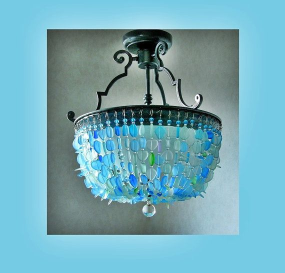 This model: the Mobile Bay  Accented by graceful metal flourishes, this semi-flush mount ceiling fixture makes a elegant statement in your