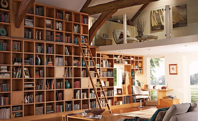 Wow- I'd love to have a library with a ladder in my house!