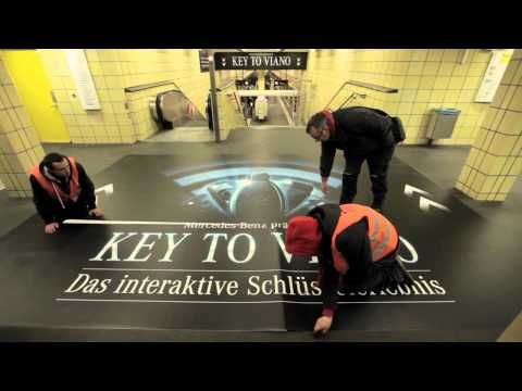 "For their client Mercedes, Lukas Lindemann Rosinski implemented an interactive outdoor event on WallDecaux AG's digital advertising displays in Berlin underground station Friedrichstrasse, which blurred the line between classical outdoor advertising and interactive entertainment. Under the slogan ""Key to Viano"", passers-by were offered the unprecedented opportunity to control digital advertising displays using their own remote car key."