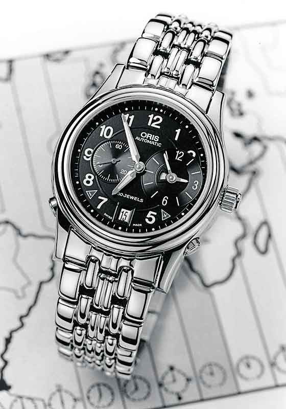 The #Oris WorldTimer, containing Caliber 690, which lets the wearer adjust the time forward or backward in one-hour jumps using pushers on the side of the case. The watch also has a patented system in which the date jumps backward if the local time is moved back over midnight.