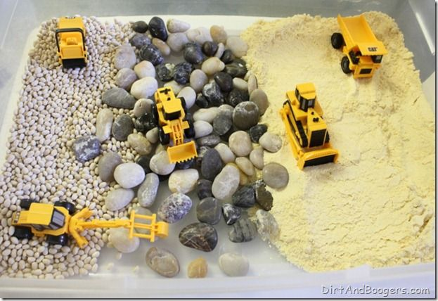 "Construction Site - white beans, river rocks/pebbles, cornmeal, trucks ("",).  I've done this for Ian and Natalie with things like chocolate chips, coconut flakes, etc.  They LOVE it.  :)"