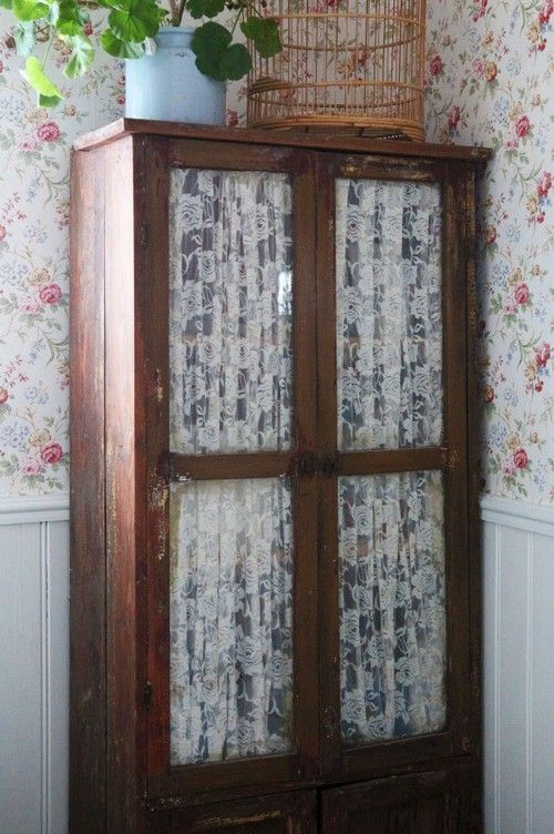 Fabric Inside Glass Doors Of Old Storage Cabinet Sewing