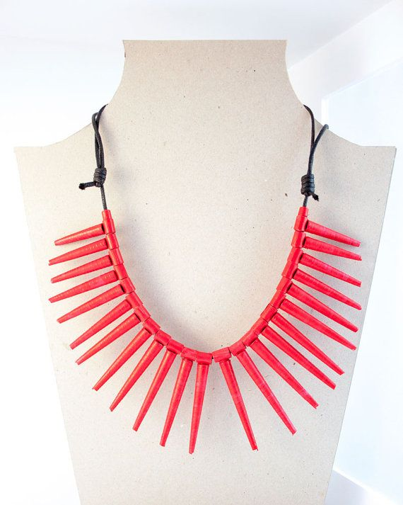 Stand out with this gorgeous red necklace! It is a handmade jewelry, a unique and original piece.   It is made of recycled and ecological paper specifically painted with red acrylic color. The manufacture was made with the quilling technique: an art that requires a lot of concentration and patience and consist in rolling paper strips. Every little red cones was made one by one.   The black waxed rope is easily adjustable with the small knots, so you can choose the length of the jewel: fully…