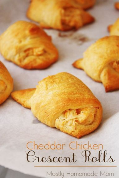 Cheddar Chicken Crescent Rolls - Cooked chicken combines with ranch dressing mix, cream cheese, & cheddar and rolled up in buttery crescent rolls - an awesome weeknight dinner and a great game day appetizer!