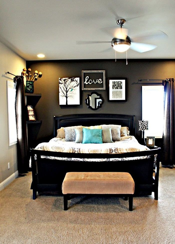 master bedroom with dark grey accent wall light grey walls dark furniture and fun