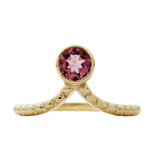 14KY PINK SAPPHIRE TIARA RING  A 0.43TCW round pink sapphire measuring 4mm is bezel set into a 14 karat yellow gold Tiara ring with granulation along the shank. This pink sapphire ring is a size 6 which can also be sized. (R647)