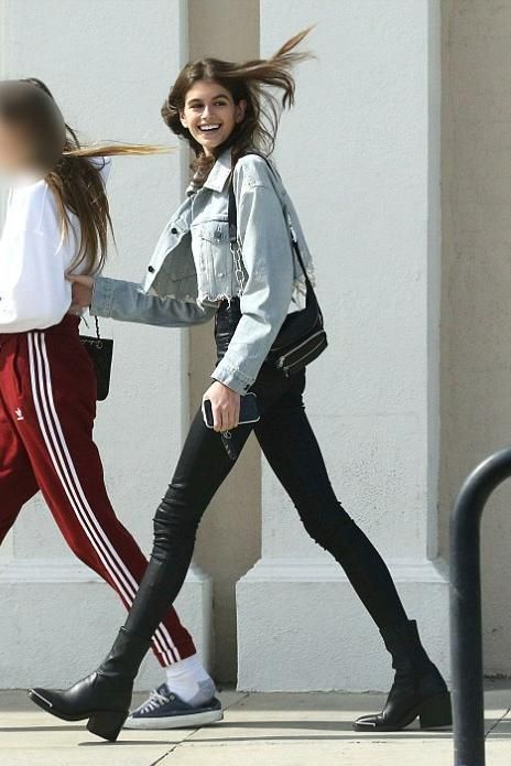 10ed33aa97de Kaia Gerber wearing Alexander Wang Attica Leather Belt Bag, Alexander Wang  Blaze Cropped Jacket, Hudson Barbara Jeans in Noir Coated and Alexander  Wang ...