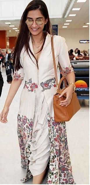 While Aishwarya Rai Bachchan is already ruling Cannes with her appearances, Sonam Kapoor has finally arrived for Cannes. Wearing an Anamika Khanna cr...