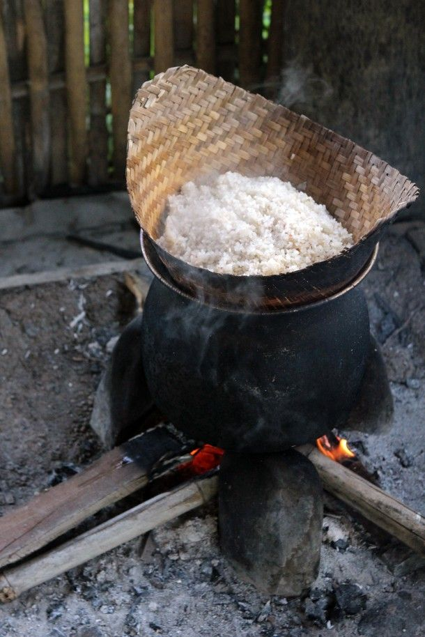 Rice cooking in a traditional steamer in Laos, Luang Prabang