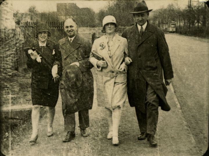 Hermann (far right) and Auguste van Pels (far left) with a married couple they're friends with. Osnabrück, 1930s.
