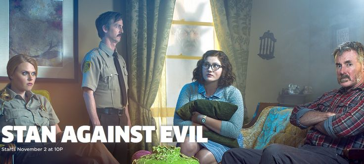 NYCC introduces us to Stan Against Evil   Image Credit: IFC  In a small New Hampshire town Sheriff Stanley Miller (John C. McGinley) loses both his wife and job all in the same day. Taking Stans place as town Sheriff Evie Barret (Janet Varney) soon discovers that dark forces threaten the town of Willards Mill. As the undead begin to rise and demons decimate the towns population Evie must team up with the one person who hates her more than the dead does the ex-Sheriff Stan. Together these…