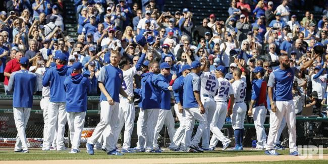 Chicago Cubs players acknowledge the fans after winning a 2017 National League Central Division Championship before the game against the…