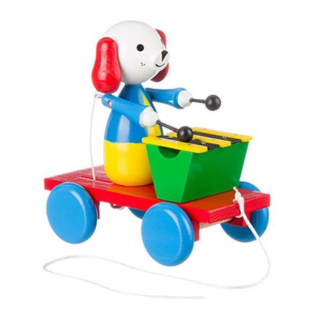Houten trekfiguur van een hond met zijn xylofoon. Pak het touwtje vast en ga met het trekfiguur lopen. De hond slaat dan vrolijk op zijn xylofoon.