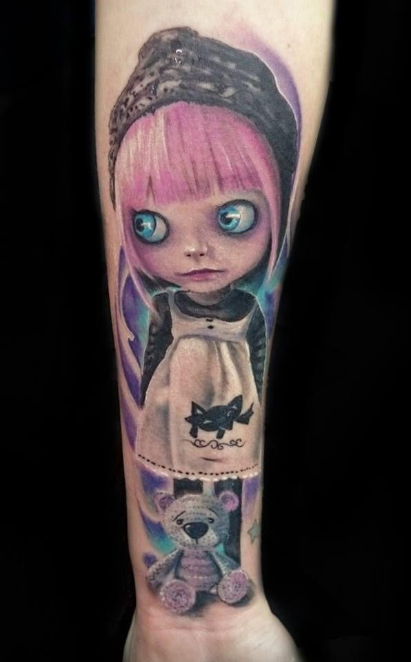 Realistic doll tattoo by Martin Danree.