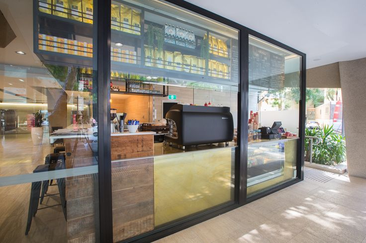 Cafe in a glass box. Design and built by Guru Projects