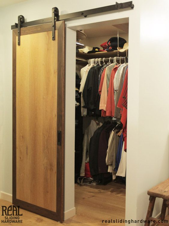 Closet utilizing hammered flat track sliding barn door for Barn door closet door ideas