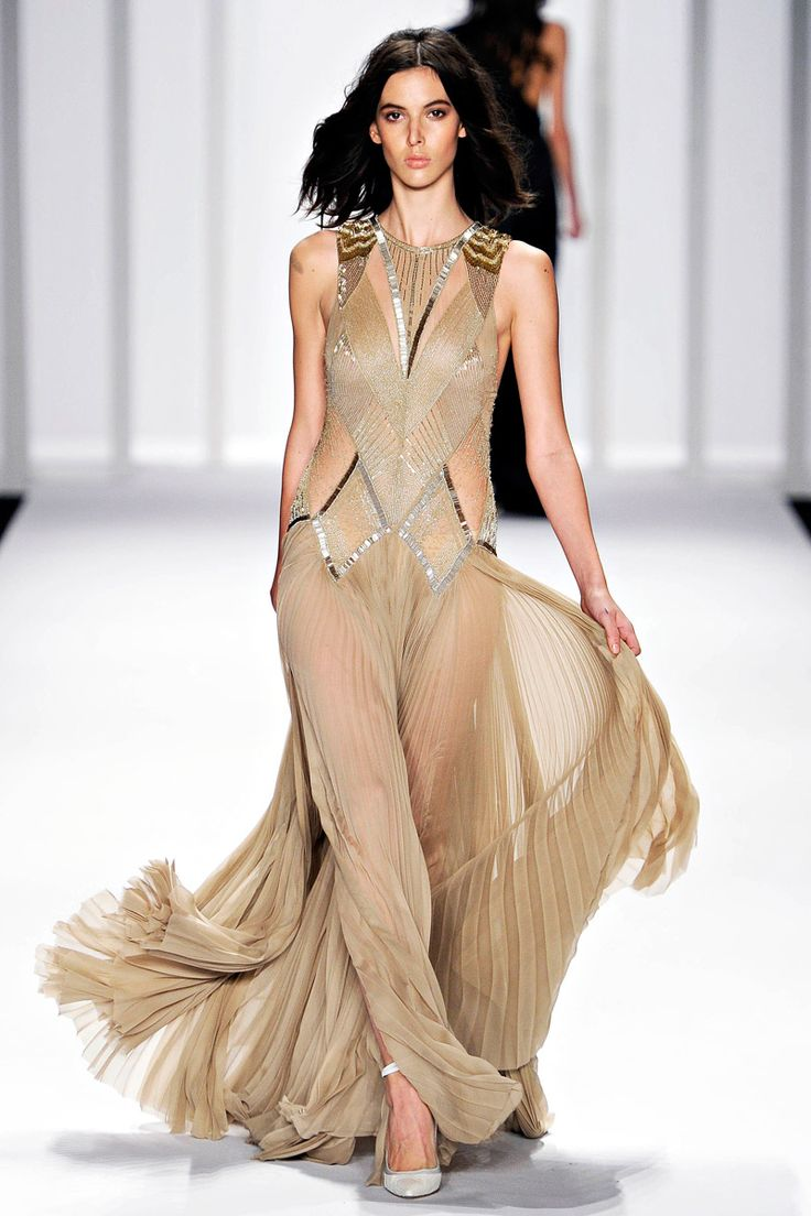 J Mendel..This gown shows just enough. Nude and sheer, without being vulgar or looking like lingerie.
