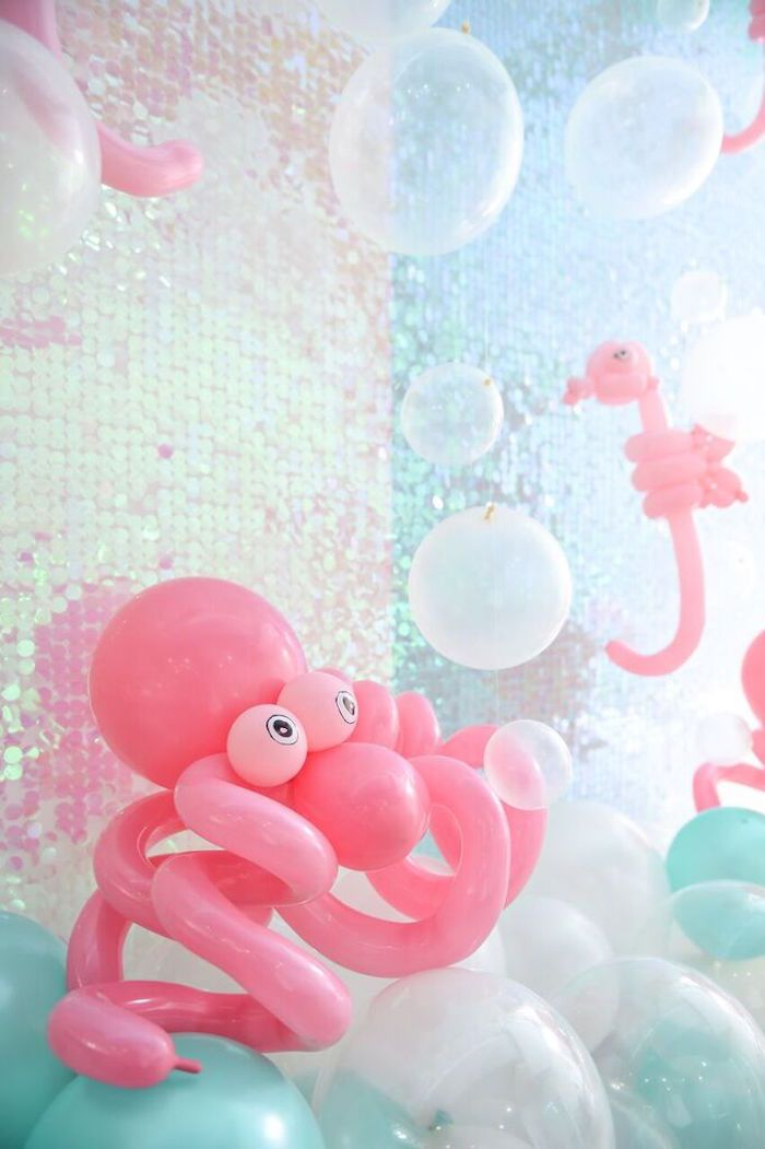 Iridescent backdrop and octopus balloon animal!