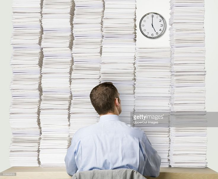 Superior Stock Photo : Businessman With Desk Covered In Paperwork Looking Up At Clock Great Pictures