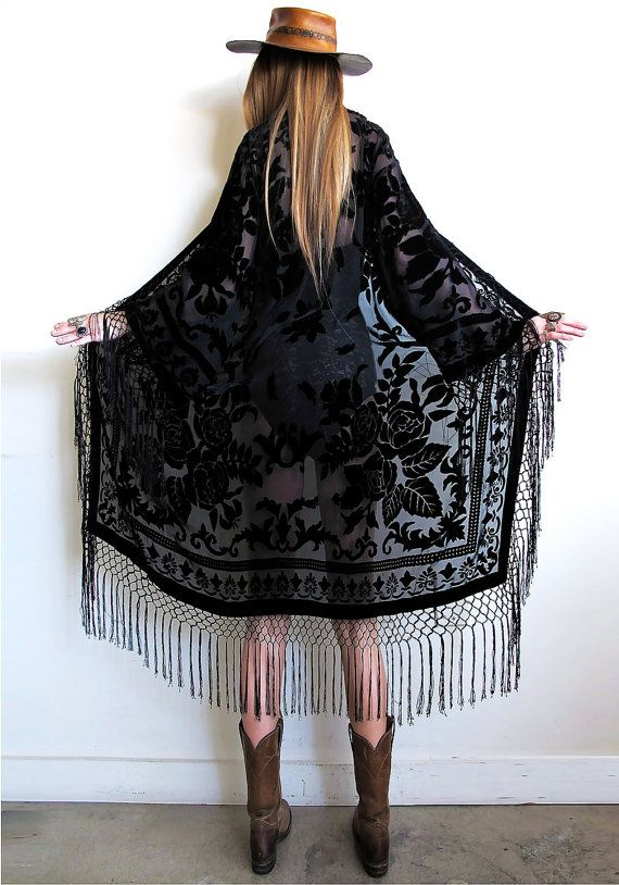 "Stevie Nicks inspired...total bohemian babe goodness with a vintage vibe.  Black on black velvet burnout with fishnet fringe dripping down the front, all along bottom, and sleeves!So many ways to wear dressed up or down, a truly timeless and effortless piece!Shown on a sz 2 model Will fit a wide range of sizes. Recommended for up to a sz 12. Measurements taken while garment is laid flat and open: Bust up to 43"" Shoulder 20.5"" Length including fringe 50""..."
