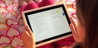 We love the Storia app from Scholastic for leveled ebooks!