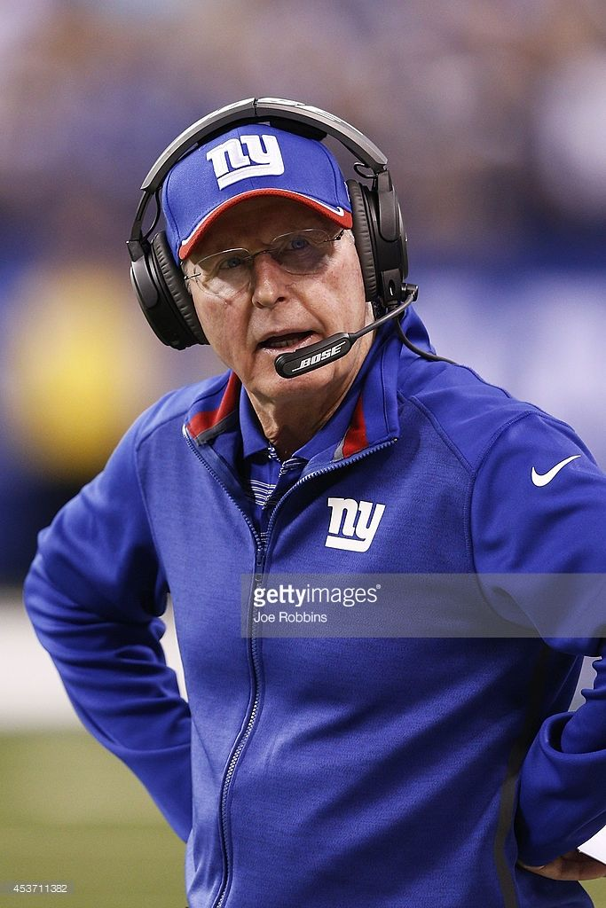 New York Giants head coach Tom Coughlin looks on in the first half of an NFL preseason game against the Indianapolis Colts at Lucas Oil Stadium on August 16, 2014 in Indianapolis, Indiana.