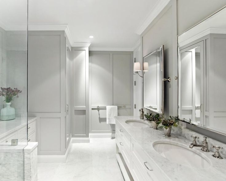 not a fan of gray but this is a lovely to the before in manhattan apartment condo master bathroom door view after