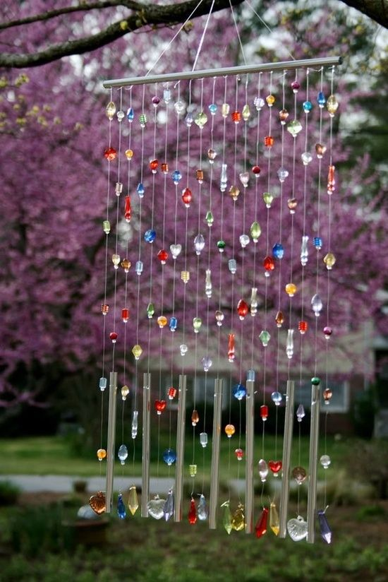 20 Marvelous DIY Wind Chimes, I like this one because it has the chimes at the bottom, could hang any items above them...