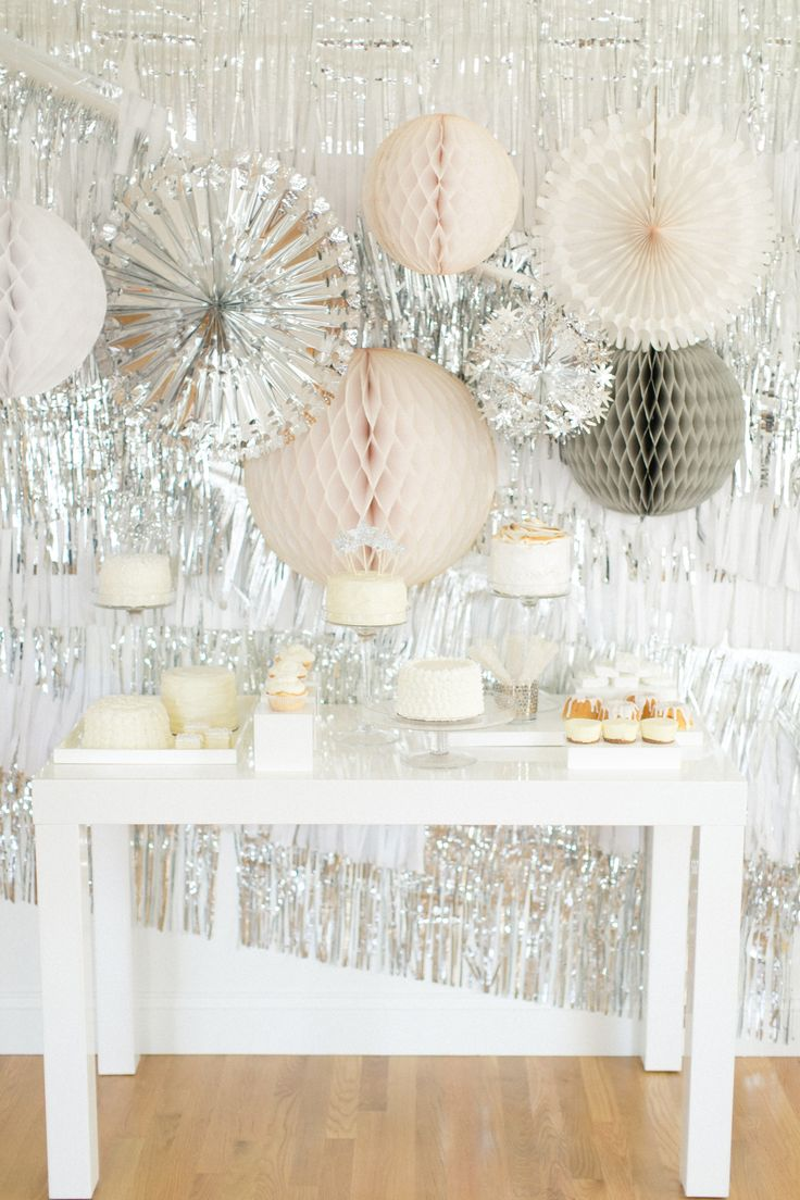 Silver dessert table backdrop |   Photography: Ruth Eileen - rutheileenphotography.com  View entire slideshow: Metallic Wedding Moments  on http://www.stylemepretty.com/collection/458/