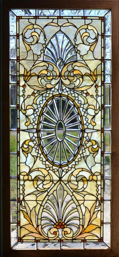 A set of 3 Antique American Stained/Jeweled and Beveled Glass Windows.  Originally installed in the Indiana Governors Mansion, the windows are in excellent condition.