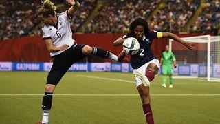 Simone Laudehr of Germany is challenged by Wendie Renard of France
