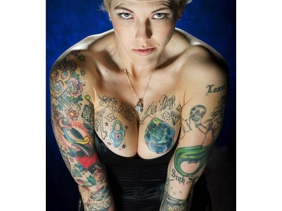 39 still waters run deep 39 tattooed across her chest the for Where do tattoos come from