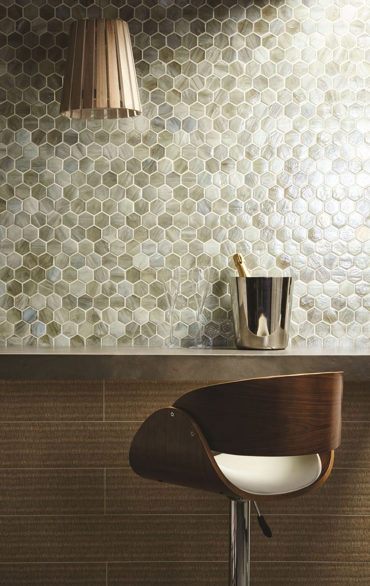 Etal iridescent glass mosaics show why hexagons are the shape of the moment. These tiles look great on walls to provide a subtle effect with depth, thanks to the variation in the colour of each tile piece. originalstyle.com