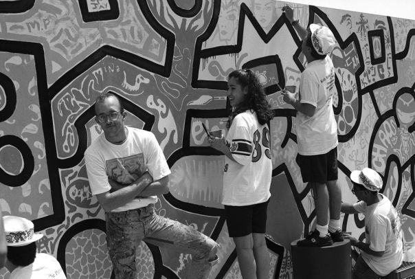 Keith Haring and CPS students working on Untitled, 1989 © Keith Haring Foundation