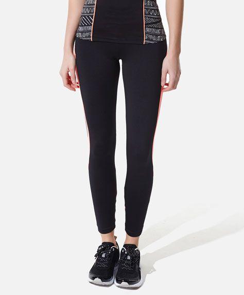 Contrasting fabric leggings - OYSHO