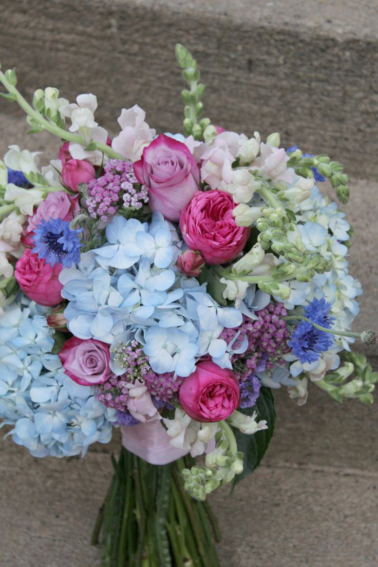 Bridal bouquet made up fresh blue hydrangeas light pink for How are blue roses made