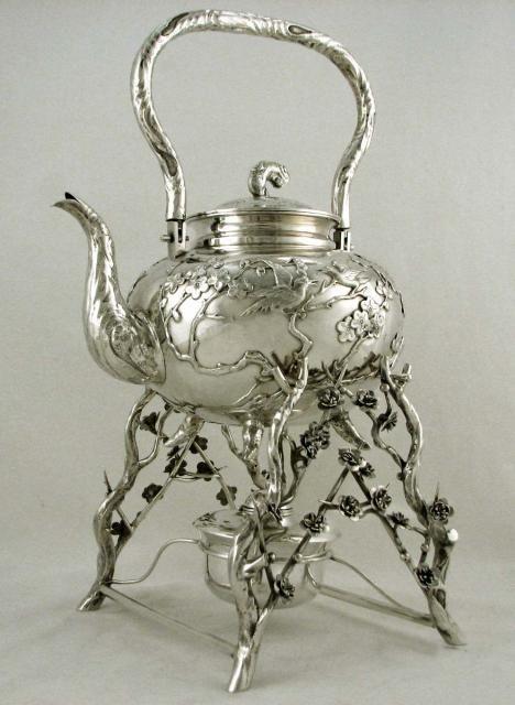 An antique sterling silver tea pot...