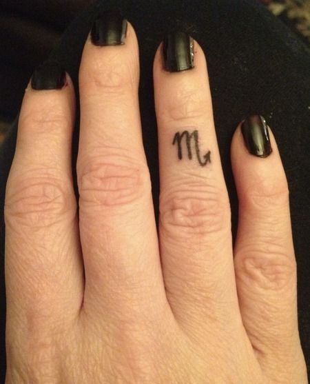 Scorpio Zodiac Tattoo on Finger