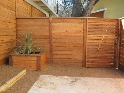 Horizontal slat modern Fence & Gate. No link, but idea to keep the dogs away.